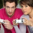 Man and woman playing video games — Stock fotografie #7784102