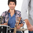 Stock Photo: Young mplaying drums
