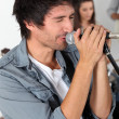 Male vocalist in a rock band — Stock Photo #7784321