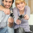 Royalty-Free Stock Photo: A couple playing video games