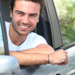 Young man sitting in his car — Stock Photo