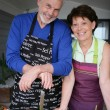 Older couple preparing an outdoor lunch — Stock Photo #7785101