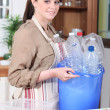 Young womwith plastic bottles — Stock Photo #7785431