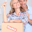 Stock Photo: Couple with key to door