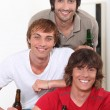 Three lads with bottles of beer — Stock Photo