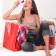 Stock Photo: Studio shot of womwith shopping bags and loudspeaker