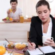 Couple eating breakfast separately — Foto de Stock