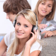 Teenagers listening to CDs — Stock Photo
