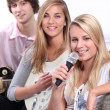Group of teenagers playing music at home — Stock Photo #7787721