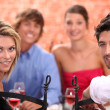 Stock Photo: Friends having dinner