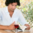 Stock Photo: Mdrinking wine on restaurant terrace