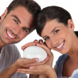 Couple holding bar of soap — Stock Photo #7788851