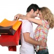 Couple holding shopping bags - Stock Photo