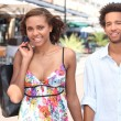Stock Photo: Black young couple walking in the street