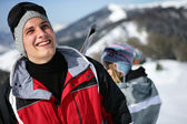 Young man in a red ski jacket — Stock Photo