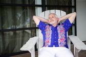 Senior relaxing on the veranda — Stock Photo