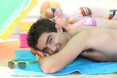 Three young sunbathing — Stock Photo