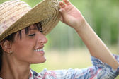 Young woman in a straw hat — Stock Photo