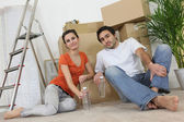 Couple sitting inside an apartment — Stock Photo