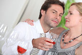 Happy couple with alcohol — Stock Photo