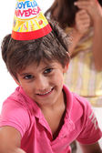 Young boy in a birthday party hat — Stock Photo