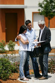 Estate-agent about to show couple around property — Stock Photo