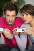 Man and woman playing video games — Stock Photo