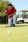 Golfer kneeling. — Stock Photo