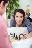 Young woman playing chess — Stock Photo