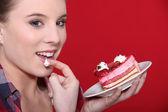 Woman eating cake — Stock Photo