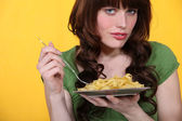 A woman eating pastas. — Stock Photo