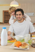 Smiling boy and girl breakfasting — Stock Photo