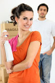 Young woman with cleaner spray in hand — Stock Photo
