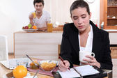 Couple eating breakfast separately — Stock Photo