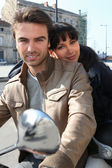 Couple on a moped — Stock Photo