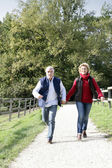 Couple walking along footpath — Stock Photo