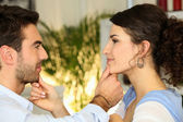 Couple touching each others faces — Stock Photo