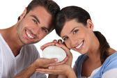 Couple holding bar of soap — Stock Photo