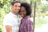 Couple in love on a countryside stroll — Stock Photo