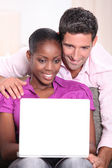 Couple on computer — Stock Photo
