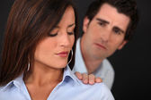 Concerned man touching his wife's shoulder — Stock Photo