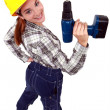 Woman with a power drill — Stock Photo