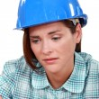 Stock Photo: Sad female builder
