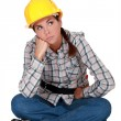 A grumbling tradeswoman — Stock Photo