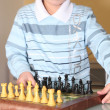 Little boy playing chess — Stock Photo