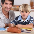 Little boy coloring with his father — Stock Photo #7790679