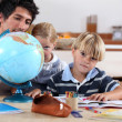 Royalty-Free Stock Photo: Brother and sister doing geography homework