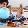 Stock Photo: Brother and sister doing geography homework