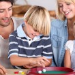 Stock Photo: Portrait of a family playing games