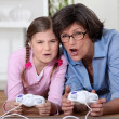 Little girl playing computer game with her grandma — Stock Photo #7790881
